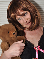 Sexy TGirl wearing a little teddy and looking incredibly cute.