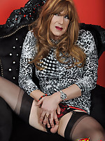 A very sexy TGirl sits on the throne and flashes her red panties.