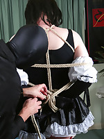 Tgirl maid gets tied and bound by man in leather mask