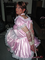 Sexy Lucimay in pink frilly dress tied too a table
