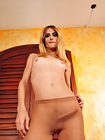 Awesome t-girl stripping up to her silky pantyhose to show her hard shaft