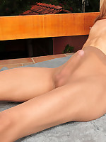 Well-shaped shemale revealing her pantyhose clad cock in every which way