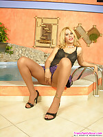 Sizzling hot blonde shemale unloading her cock on tan pantyhose by the pool