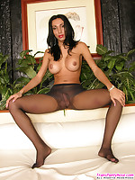Salacious shemale with yummy boobs posing topless in control top pantyhose